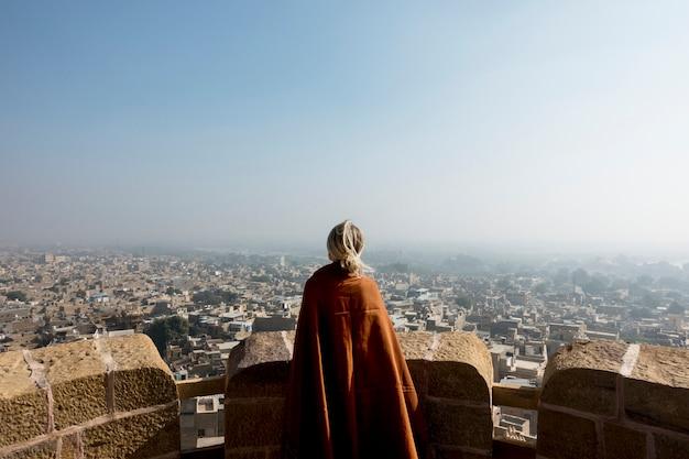Western woman exploring jaisalmer fort, rajasthan, india