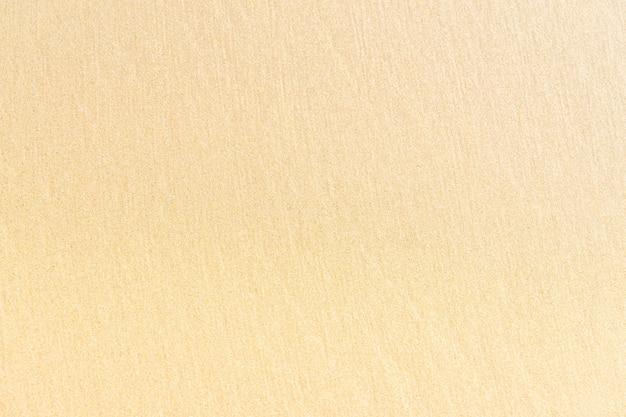 濡れた砂のテクスチャの背景を詳細にクローズアップ。ビーチで砂。