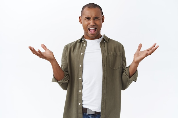 Whats your problem. portrait of frustrated and annoyed african-american man, spread hands sideways complaining