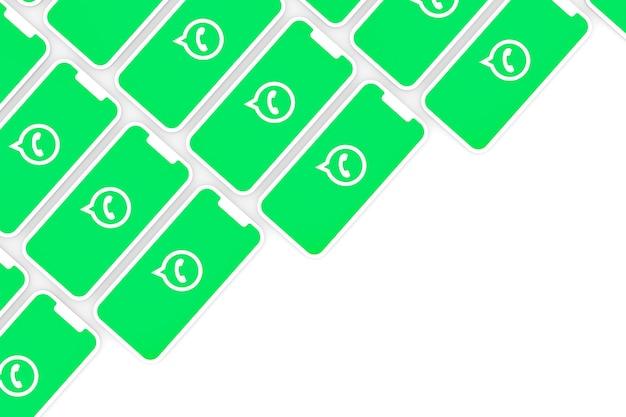 画面のスマートフォンまたはモバイル3dレンダリングのwhatsappロゴ