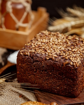 Wheat black bread sprinkled with seeds