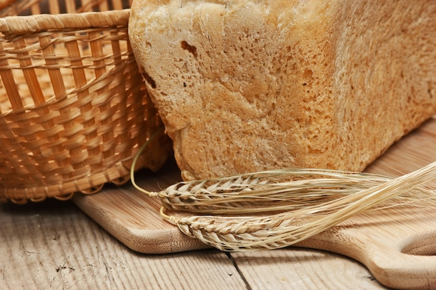 Wheat bread on the wooden table