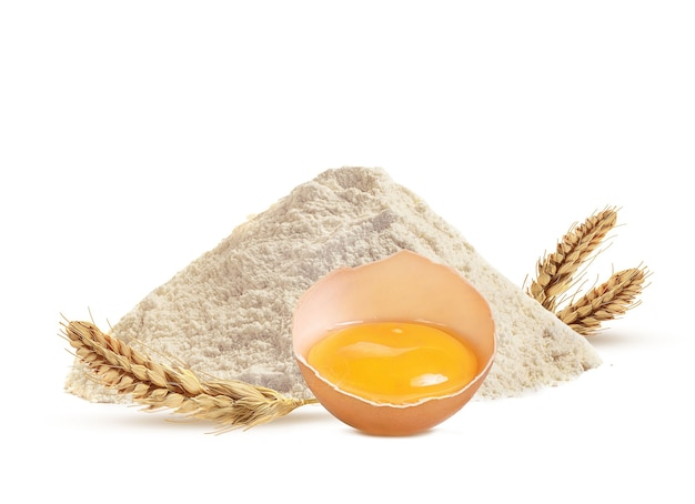 Wheat flour and egg on white background
