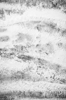 素朴なテーブルの上の小麦粉。上面図