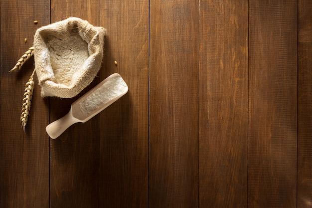 Wheat flour on wooden texture