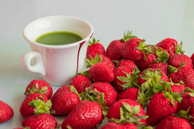 Wheat germ juice, matcha tea and red strawberry. healthy eating