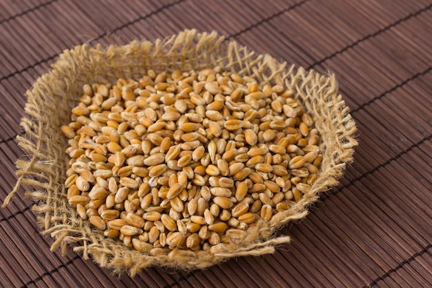 Wheat grains on a brown table