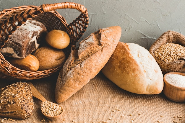 Wheat loaves with buns in basket