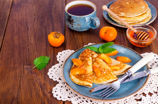 Wheat pancakes with honey and apricots