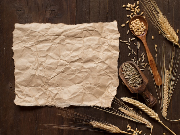 Wheat and spelt on an old wooden background