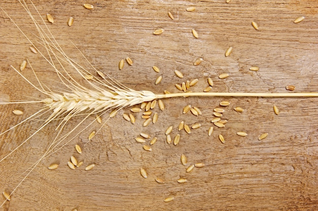 Wheat on wooden texture background