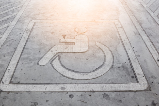 Wheel chair  park signage on parking lot floor