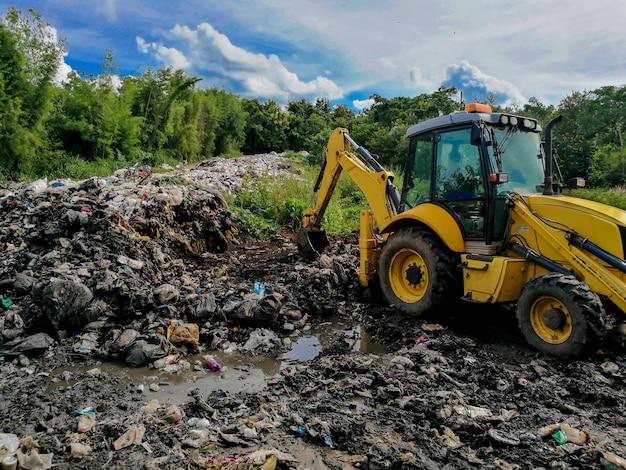 Wheel loader digging gabage at the landfill.