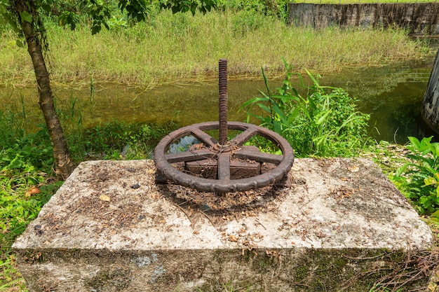 The wheel of the valve on the old dam in khao lak, thailand.