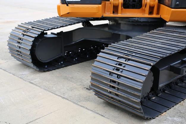 Wheel of yellow track-type loader excavator