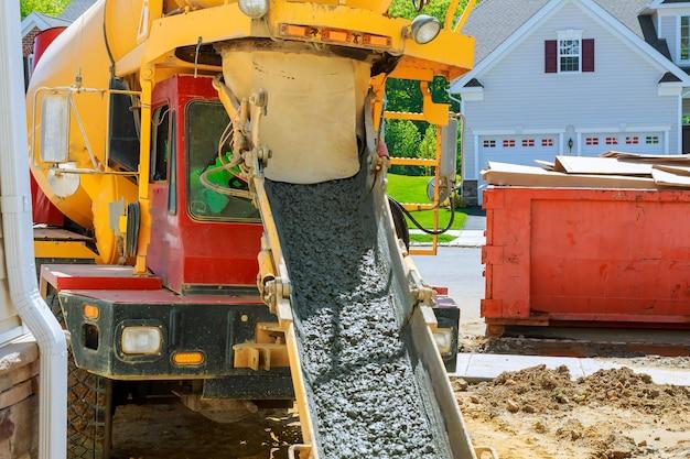 Wheelbarrow with shovel full of cement