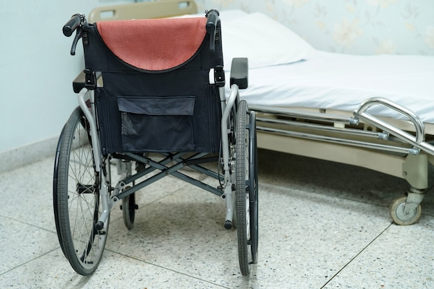 Wheelchair and bed equipment for patient in hospital ward or clinic.