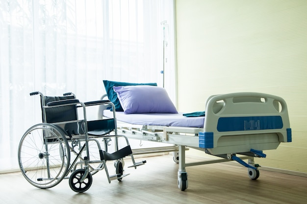 Wheelchair and bed in the hospital waiting used for sick people.
