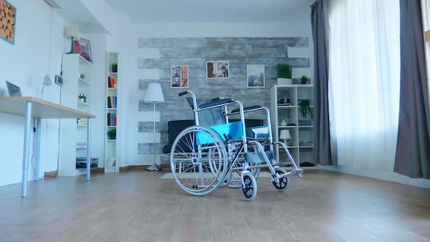 Wheelchair in clinic room for people that need assistance with physical illness.