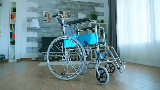 Wheelchair for disabled patient in empty room