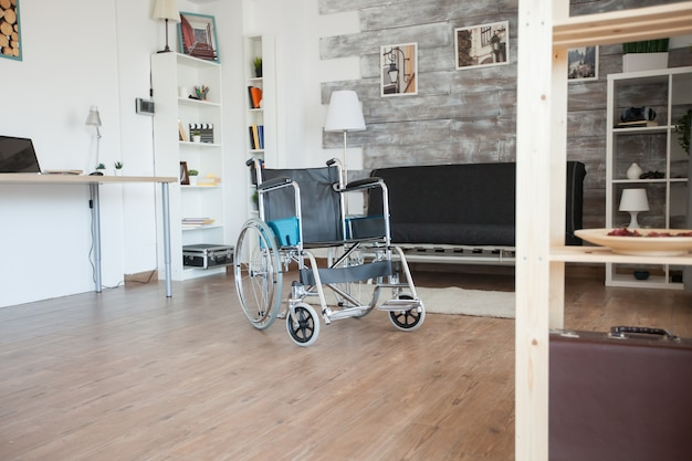 Wheelchair in nursing home for disabled patient. no people in the room in the private nursing home. therapy mobility support elderly and disabled walking disability impairment recovery paralysis inval
