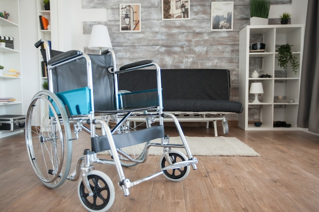 Wheelchair parked in hospital private room for patient with mobility disability. no patient in the room in the private nursing home. therapy mobility support elderly and disabled walking disability im
