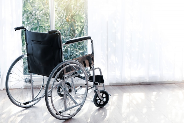 The wheelchair patient bed is in the hospital ward.