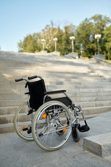 Wheelchair at the stairs, nobody, handicap problem