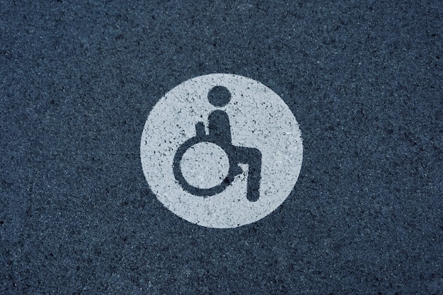 Wheelchair traffic signal on the asphalt