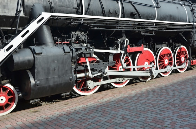 Wheels of the old black steam locomotive of soviet times.