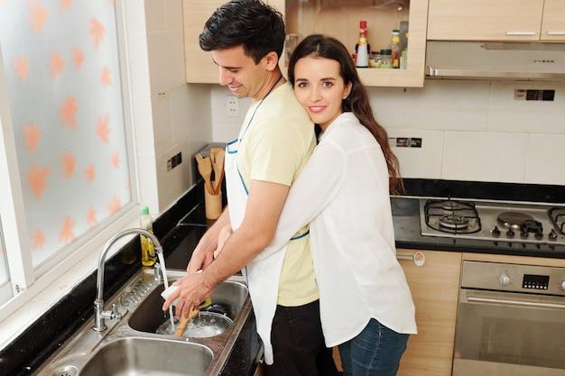 When husband washing dishes
