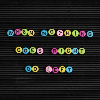 When nothing goes right go left beads word typography