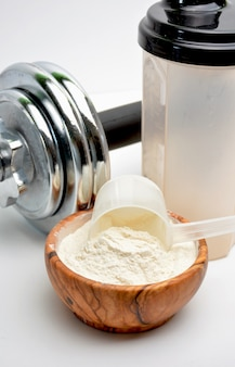Whey protein taste vanilla with dumbbell