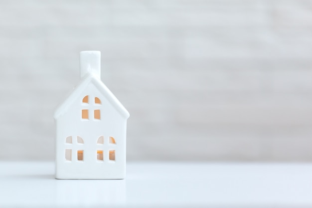 Whhite house with place for text on white background. stay at home concept