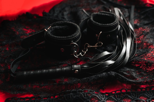 Whip and handcuffs with lace underwear for bdsm sex