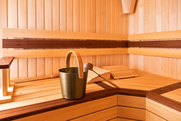 Whisk, bucket and ladle for sauna. lie on the bench.
