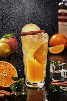 Whiskey based cocktail with lemon and orange juices apple pie syrup cider cinnamon