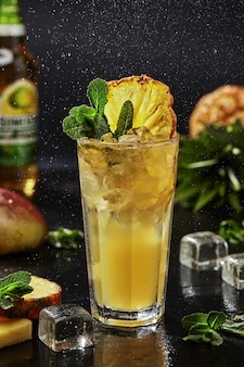 Whiskey based cocktail with yuzu puree spicy mango syrup apple cider