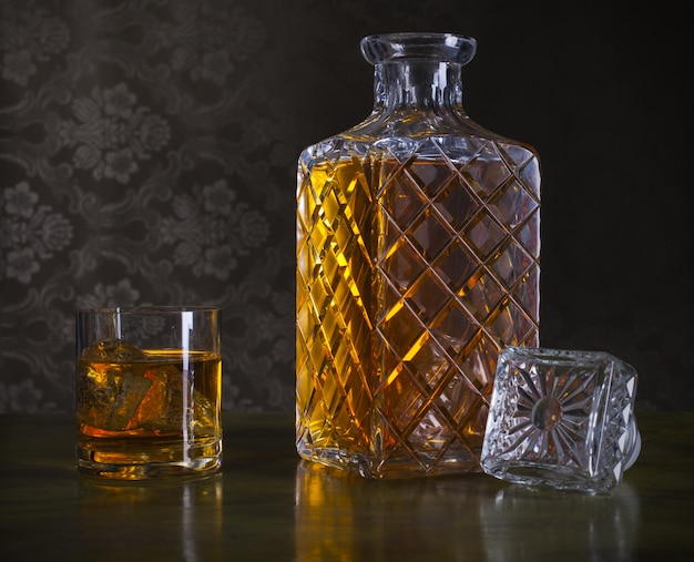 Whiskey  in bottle and glass with ice