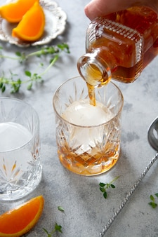 Whiskey, brandy or bourbon alcohol drink in crystal glasses