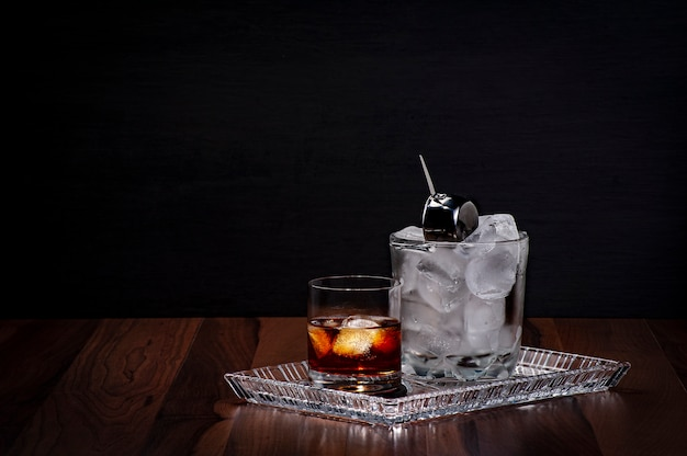 Whiskey glass and ice bucket