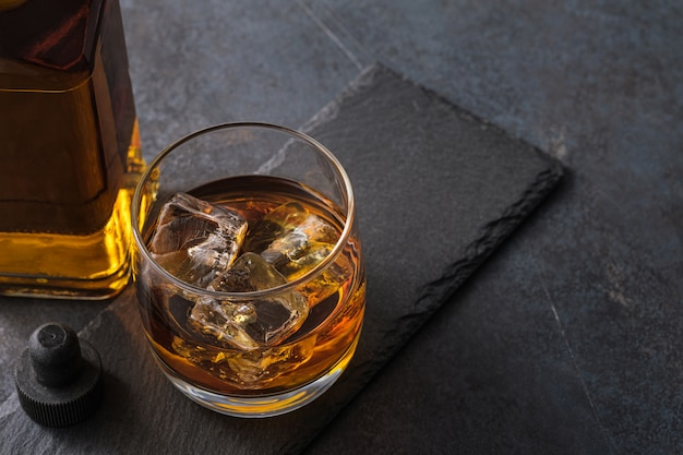 Whiskey glass with cubes