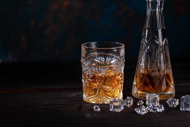 Whiskey in glass with ice