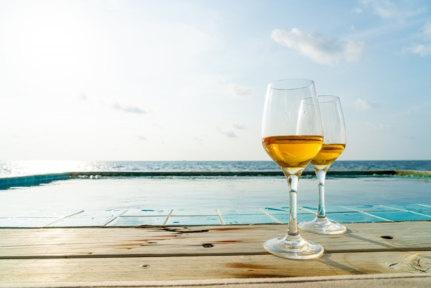 Whiskey glass with swimming pool and sea