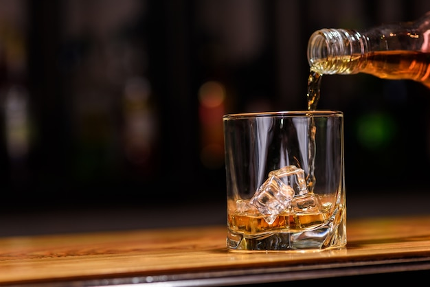 Whiskey into glass