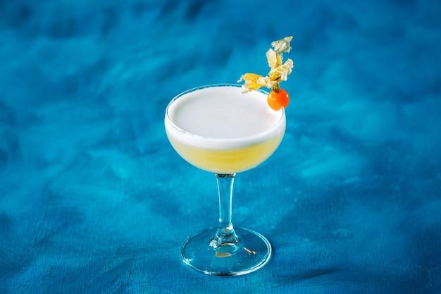 Whiskey sour physalis garnish in margarita glass