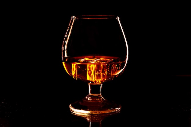 Whiskey with ice in glass isolated. drink with ice