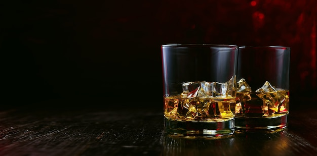 Whiskey with ice in modern glasses