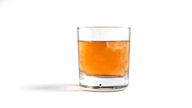 Whiskey with ice on white
