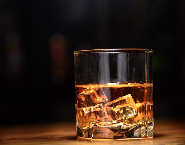 Whisky glass on dark background